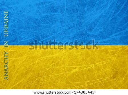 A grunge flag of Ukraine. Anarchy in Ukraine message - stock photo