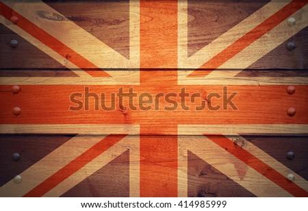 A grunge United Kingdom flag on wooden background - stock photo