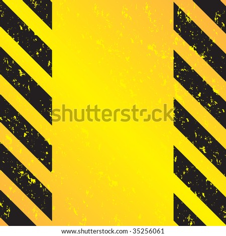 A grungy and worn hazard stripes texture in yellow and black. - stock photo