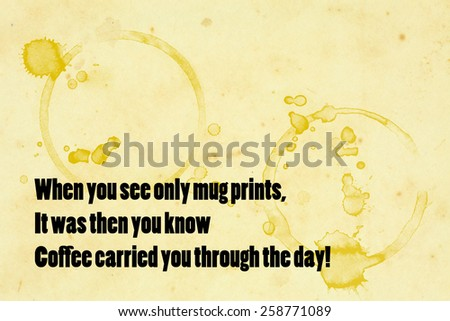 "A grungy paper napkin with coffee mug stain and the message quote ""When you see only mug prints, it was then you know coffee carried you through the day!"". - stock photo"
