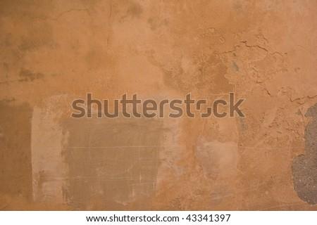 A grungy rough terracotta wall texture ! - stock photo