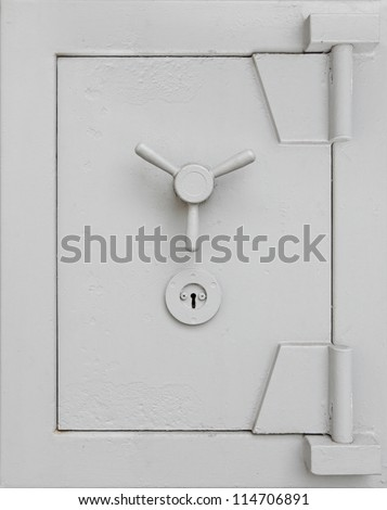 A grungy solid safe vault door. - stock photo