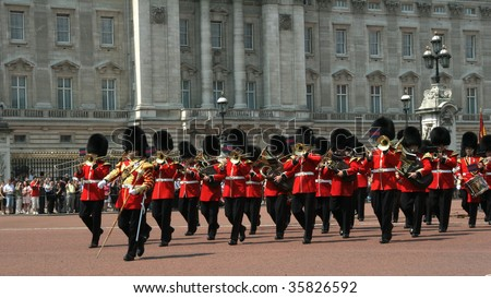 a guards band marching in front of buckingham palace - stock photo