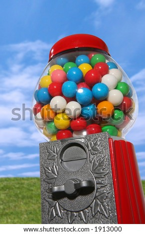 A gumball machine with a colorful nature background - stock photo