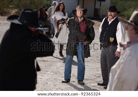 A gunfight is about to begin in an old western town. - stock photo