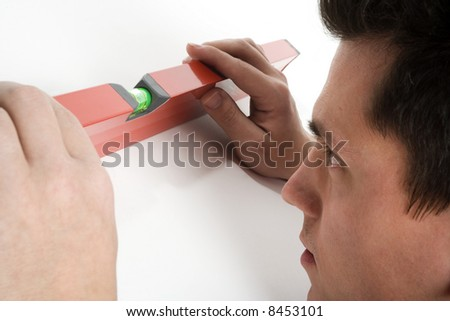 a guy aligning some work for construction - stock photo