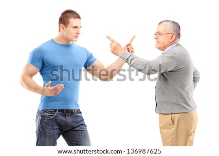 A guy and mature man arguing isolated on white background - stock photo