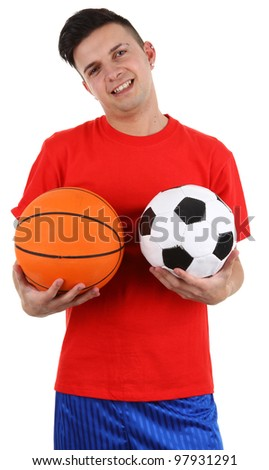 A guy holding a football and a basketball, isolated on white - stock photo