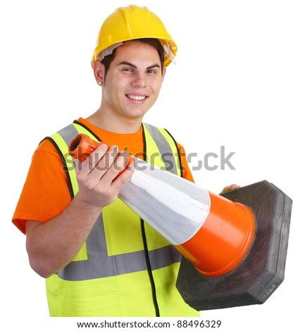 A guy holding a road cone smiling. - stock photo