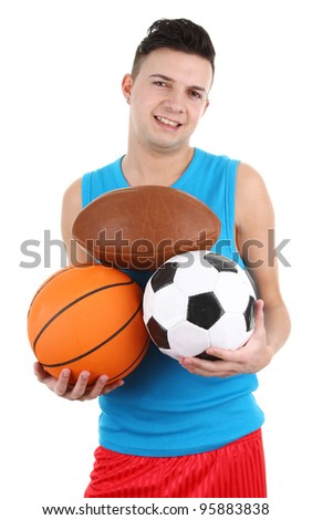 A guy holding different sports balls, isolated on white