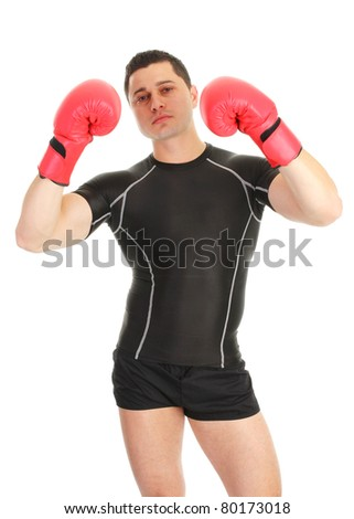 A guy holding up gloves with a black shirt on