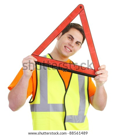 A guy in a hiviz with a hazard warning triangle - stock photo