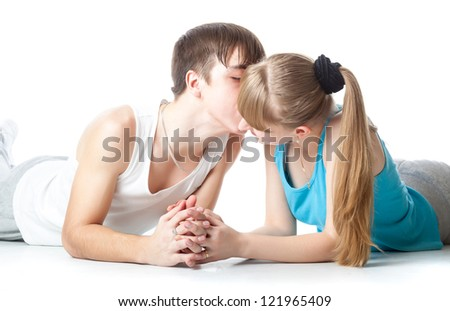 A guy is kissing his girlfriend. Isolated on a white background