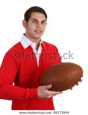 A guy wearing a rugby shirt and holding a ball - stock photo