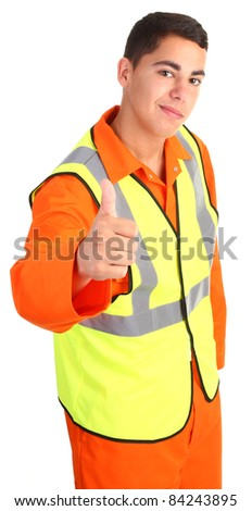 A guy wearing safety equipment with a thumbs up sign - stock photo