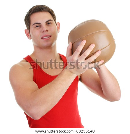 A guy with a medicene ball in a red top - stock photo