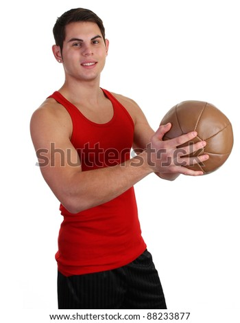 A guy with a medicene ball in a red vest - stock photo