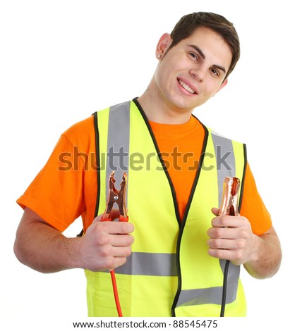 A guy with a set of jump leads in a hiviz top - stock photo