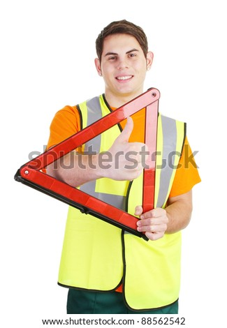 A guy with a thumbs up sign through a hazard warning triangle - stock photo