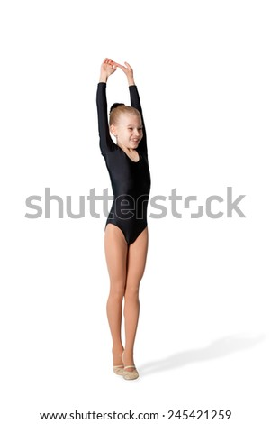 A gymnast doing exercises well white background - stock photo
