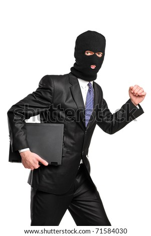 A hacker in robbery mask running with laptop isolated against white background - stock photo