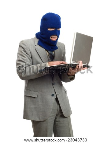 A hacker wearing a business suit is stealing company secrets - stock photo