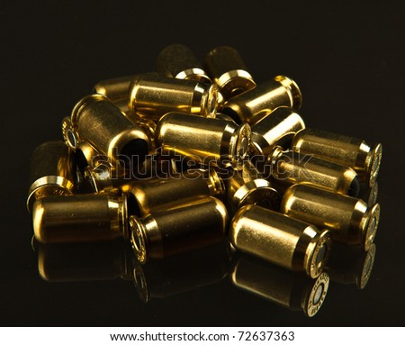 A hadful of bullets over a dark backgound - stock photo