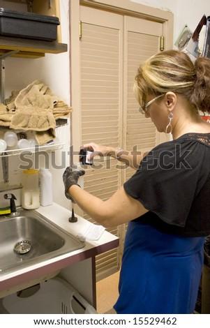 A hairdresser mixing up a precise hair color formula. - stock photo