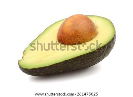 a half avocado on white background  - stock photo
