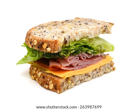 A half big sandwich meal isolated white - stock photo