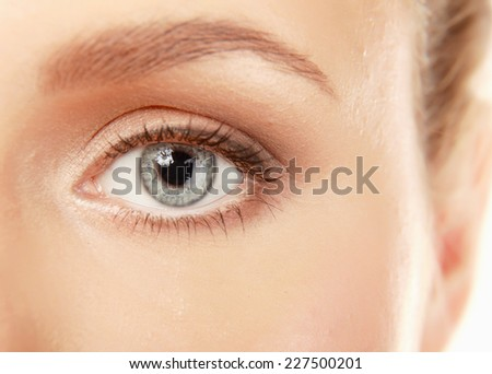 A half of a beautiful female's face, closeup, isolated on white - stock photo