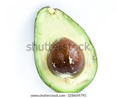 A half of organic fresh ripe avocado isolated on white background