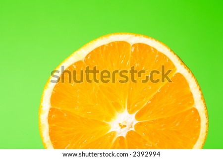 A half orange on green surface