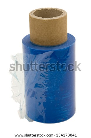 A half used roll of blue transparent nylon wrap, isolated on white background. - stock photo
