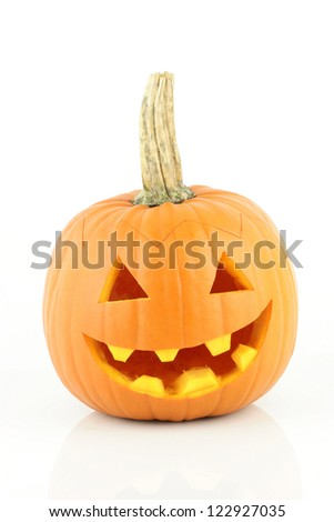 A halloween pumpkin face smiling on a white background.