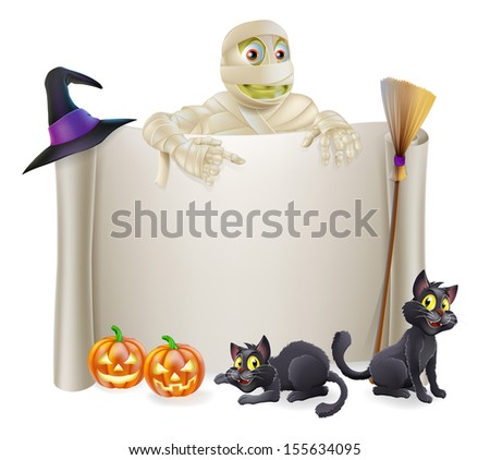 A Halloween scroll sign with a mummy character above the banner and pumpkins, witch's cats, hat and broomstick - stock photo