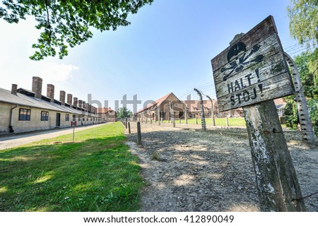 A halt sign in a concentration camp - stock photo