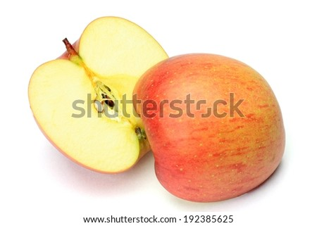 A halved red apple on a white background. - stock photo