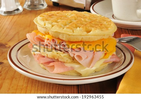 A ham, turkey and cheese sandwich on a waffle