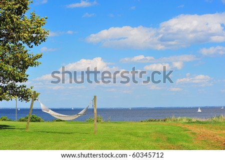 A hammock by the Chesapeake Bay in Maryland on a sunny day. - stock photo