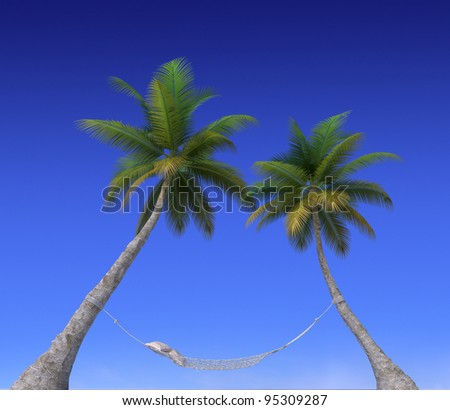 A hammock hanging from palm trees and the sky - stock photo