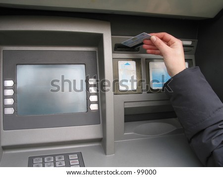 a hand, a credit card and ATM, trying to get money. - stock photo