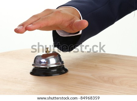 A hand about to press a bell