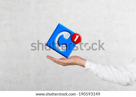 A hand and a 'telephone' icon - stock photo
