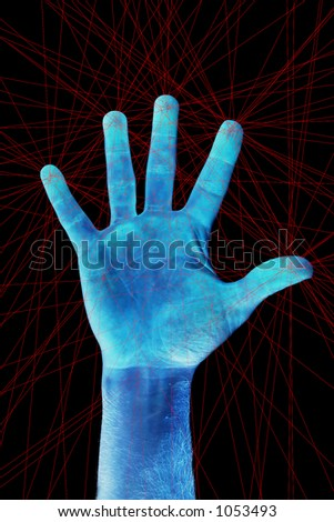 A hand being scanned for finger prints.  There are many scanning laser red lines on the image. - stock photo
