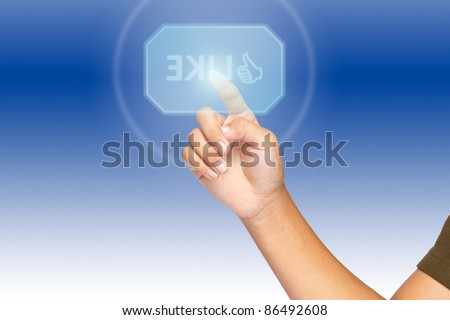 A hand click on illuminated like button - stock photo