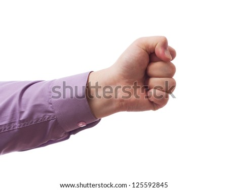 A hand clutched in his fist - stock photo