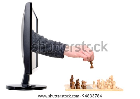 a hand coming from a computer plays chess
