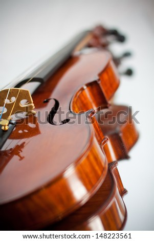 A hand crafted violin reflected in a mirror - stock photo