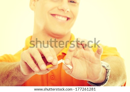 A hand crushing cigarette, isolated